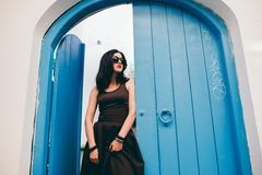 Beautiful girl near wooden doors Royalty Free Stock Images