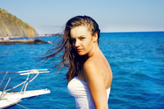 Beautiful girl near yacht Royalty Free Stock Photos