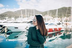 Beautiful girl near the yacht stock photo