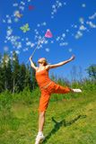 Beautiful girl with a net. In her hand trying to catch magic butterfly Royalty Free Stock Photography
