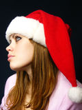Beautiful girl in a New Year's cap Royalty Free Stock Photo