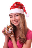 Beautiful girl with New Year tiger. Stock Images