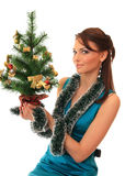 Beautiful girl with new-year tree. Royalty Free Stock Image