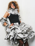 Beautiful girl in a newspaper dress Stock Photography