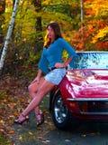 Beautiful Girl next to Corvette in Fall Stock Photo
