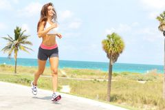 Beautiful girl with nice body running near ocean Stock Photos
