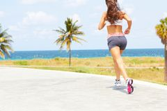 Beautiful girl with nice body running near ocean Royalty Free Stock Images