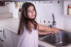 Beautiful girl in the nice white kitchen (series) Stock Photo