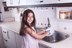 Beautiful girl in the nice white kitchen (series) Royalty Free Stock Image