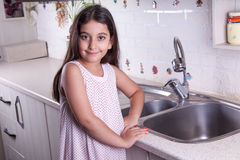 Beautiful girl in the nice white kitchen (series) Royalty Free Stock Images