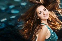 Beautiful girl in a nightclub scene Stock Image