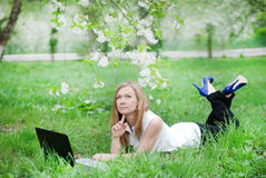 Beautiful girl with a notebook. At garden Royalty Free Stock Image