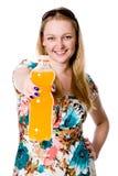 Beautiful girl offering orange juice Royalty Free Stock Photo