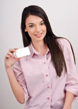 Beautiful girl offering you a visit card. Stock Photo