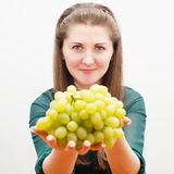 Beautiful girl offers grapes Stock Photos