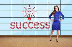 Beautiful girl  in office. And success on plasma wall Stock Photos
