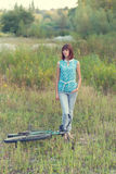 Beautiful girl with an old bicycle. Stock Images