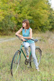 Beautiful girl with an old bicycle. Royalty Free Stock Photo