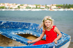 Beautiful girl in old boat Royalty Free Stock Image