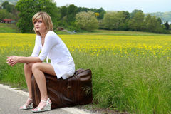 Beautiful girl on old suitcase Royalty Free Stock Images