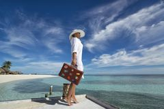 Beautiful girl with a old vintage suitcase in a beach Royalty Free Stock Photography