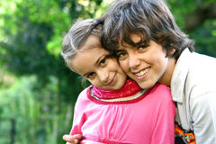 Beautiful girl with older brother, outdoor Royalty Free Stock Images