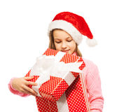 Beautiful girl open Christmas present Royalty Free Stock Photography