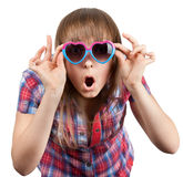 Beautiful girl in open-mouthed sunglasseses Stock Photos