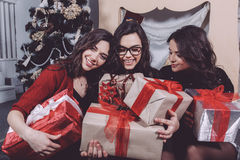 Beautiful girl opening Christmas gifts stock images