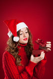 Beautiful girl opening Christmas present Stock Photo