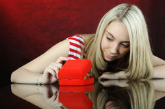 Beautiful girl opening jewellery gift box. Royalty Free Stock Images