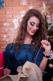 Beautiful girl opening the presents Stock Photography
