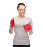 Beautiful girl opening red gift box Stock Photo