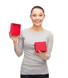 Beautiful girl opening red gift box Royalty Free Stock Images
