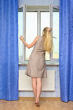 Beautiful Girl Opening Window Stock Images