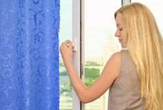 Beautiful Girl Opening Window Royalty Free Stock Photos