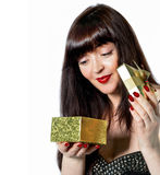 Beautiful girl opens a gift Stock Images