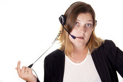 The beautiful girl operator in ear-phones Stock Photography