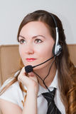 Beautiful girl - the operator in headphones Royalty Free Stock Image