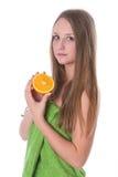 Beautiful girl with orange Royalty Free Stock Photo