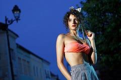 Beautiful girl with orange bra. Beautiful girl in orange bra and short skirt at night in park stock photos
