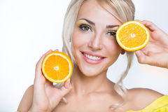 Beautiful girl with orange Stock Photography