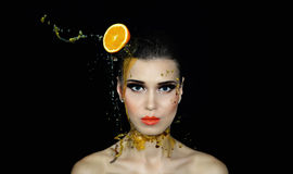 Beautiful girl and orange juice. Beautiful girl which head Orange and orange juice royalty free stock photography