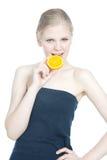 Beautiful girl with orange over white Royalty Free Stock Photos