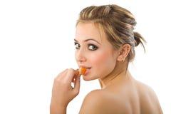 Beautiful girl  with orange segment. Royalty Free Stock Image