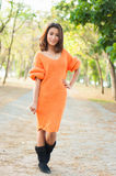 Beautiful girl in orange suit show fashion concept Royalty Free Stock Image