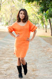 Beautiful girl in orange suit show fashion concept Royalty Free Stock Photo