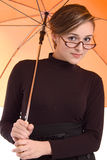 Beautiful girl with orange umbrella and glasses Royalty Free Stock Images