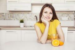 Beautiful Girl with Orange Royalty Free Stock Photography