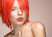Beautiful girl in an orange wig cosplay style with bright creative lips. Art beauty image. Royalty Free Stock Photos